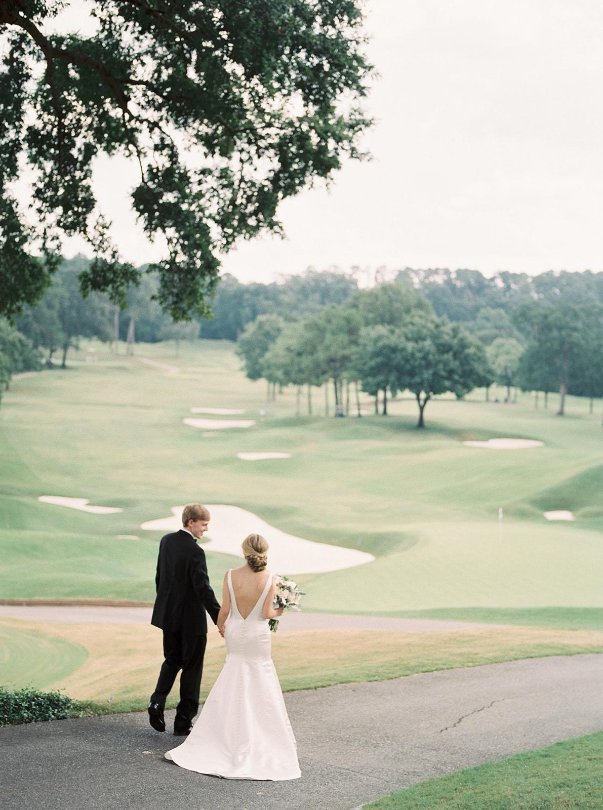 Bride and groom, open back wedding dress | Country club wedding | Birmingham, Alabama wedding | Taylor Dane Photography | Custom wedding invitations by Little Fox Paperie | Gracie Nunez