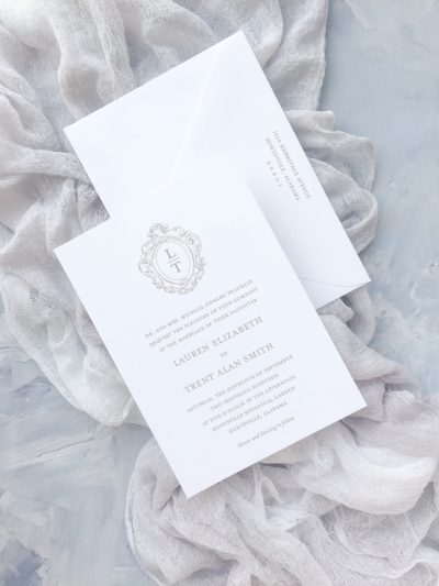 This invitation suite features a crest from the wedding collection. The wedding collection is made up of a traditional layout and artful elements to tailor your wedding invitation to your style. Available in digital printing, letterpress, and foil stamping. Custom wedding invitations by Little For Paperie.