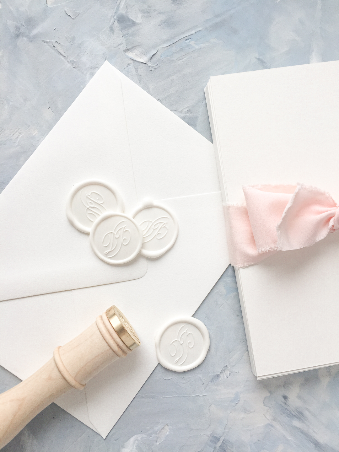 Monogram wax seals can be added to any order in the wedding collection. The wedding collection is made up of a traditional layout and artful elements to tailor your wedding invitation to your style. Available in digital printing, letterpress, and foil stamping. Custom wedding invitations by Little Fox Paperie.