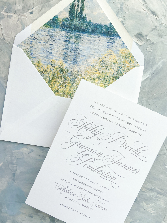 Flourished wedding invitation with monet painting envelope liner.
