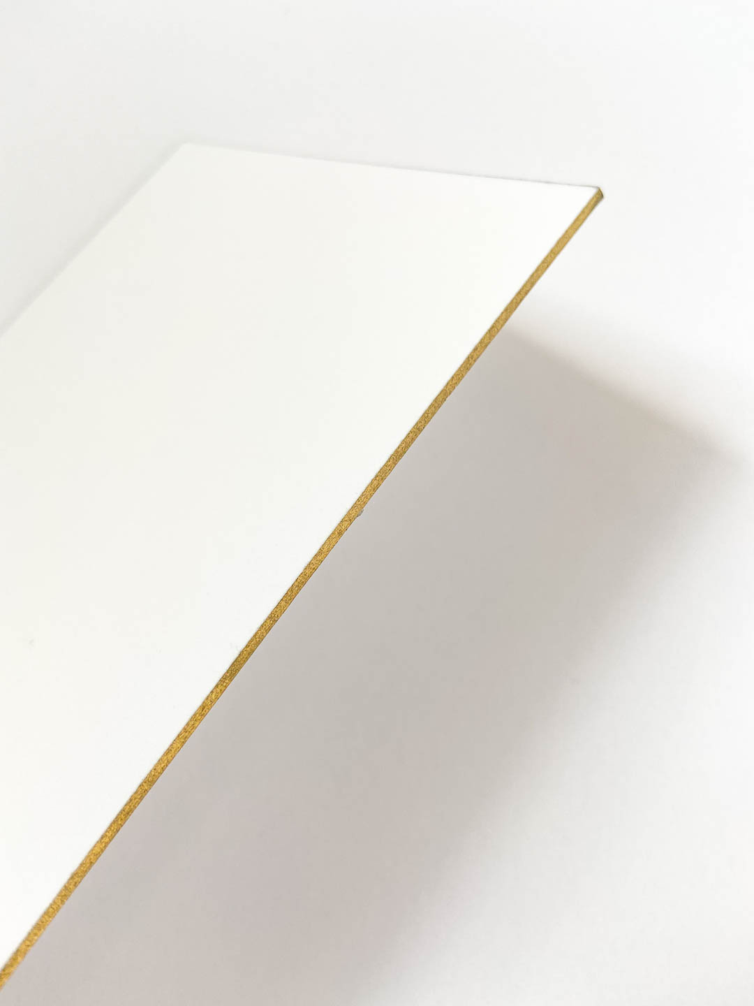 Double thick paper with gold edge painting.