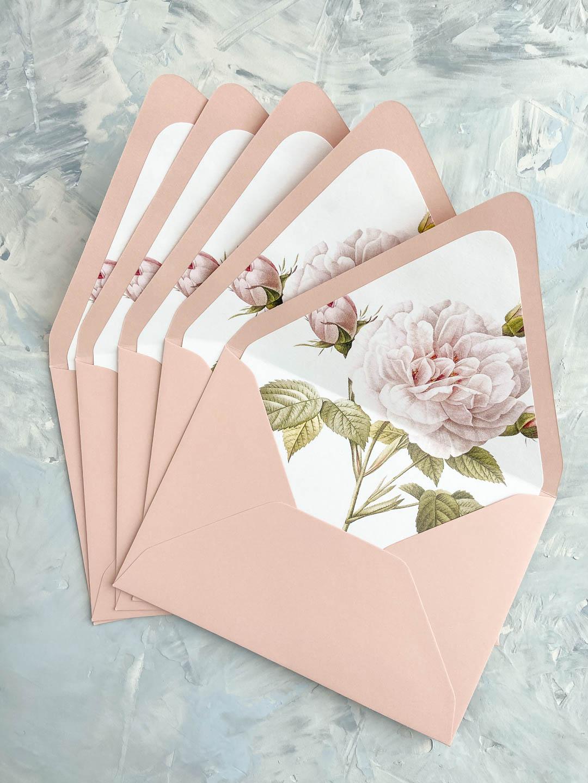 Pink rose floral envelope liner in blush envelope.