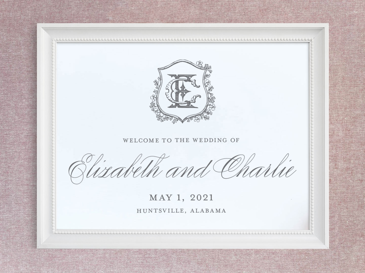 Wedding welcome sign with floral crest and vintage monogram.