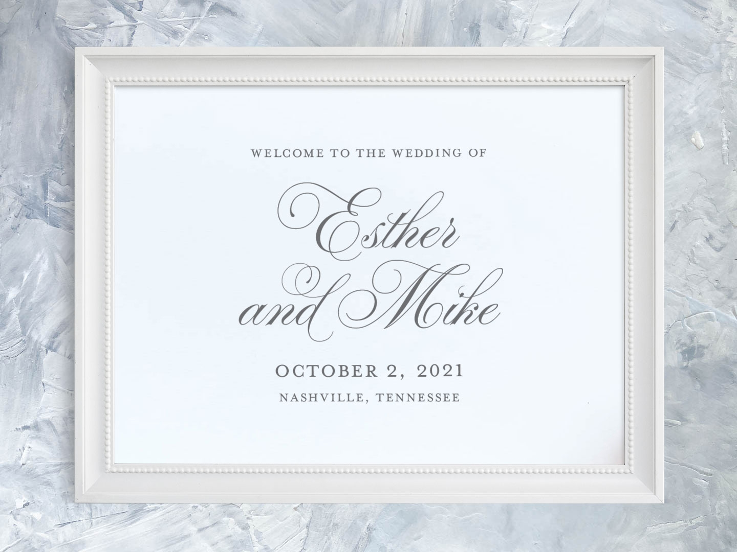 Wedding welcome sign with fancy flourished script names.