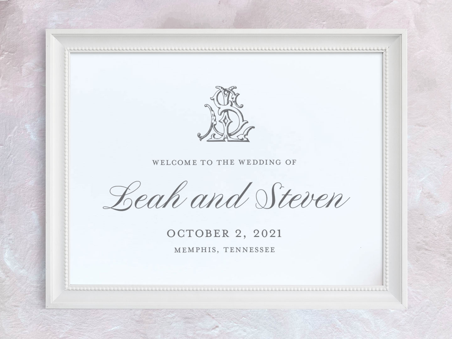 Wedding welcome sign with classic script font and interlocking monogram.
