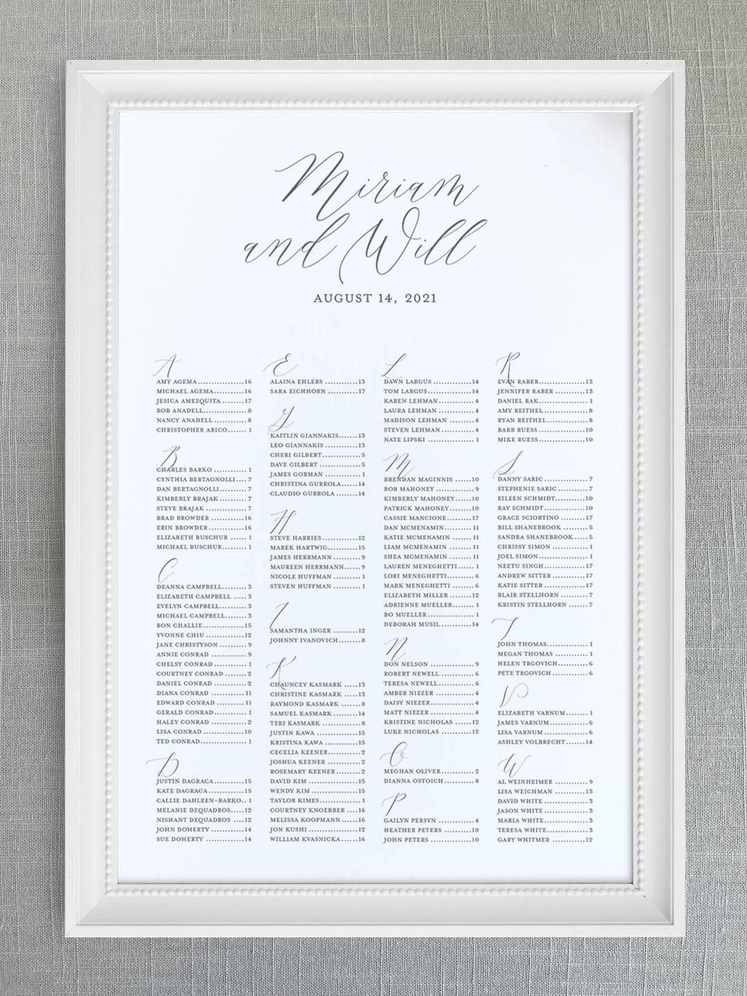 Wedding seating chart with modern calligraphy font organized alphabetically.