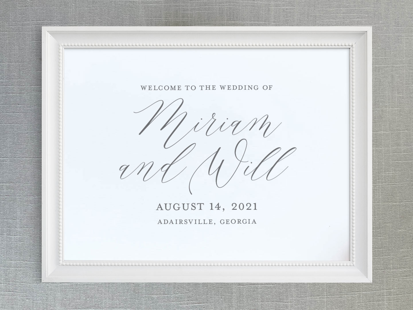 Wedding welcome sign with modern calligraphy script names.