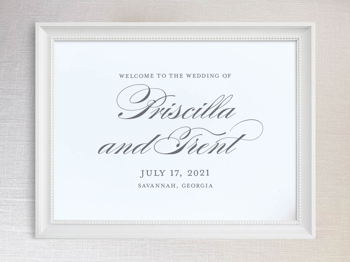 Wedding welcome sign with formal script names.