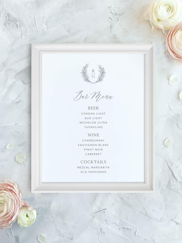 Wedding bar menu with greenery wreath and minimal modern monogram. Beer, wine, signature cocktails menu.