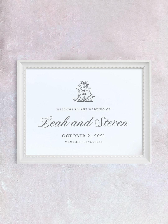 Classic script wedding welcome sign with interlocking monogram.